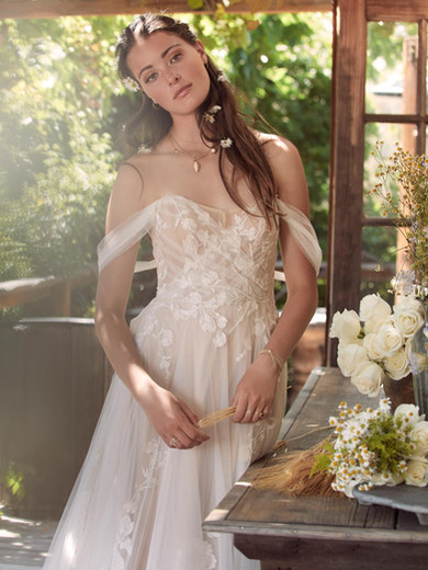 Style: Maudie  Maudie is enveloped in custom botanical embroidery. This boho beauty features an off the shoulder neckline, romantically draped sleeves, and a soft net, tie back for an extra-whimsical finish.  SIZES: 00–24W
