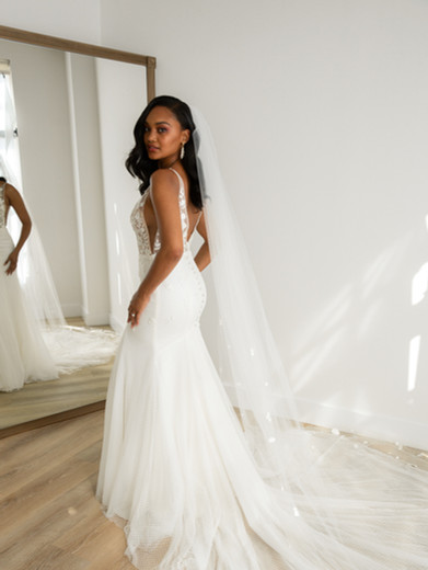 Style: Renee  This gown features a meticulously hand-embroidered bodice, with floral details trickling into the fitted skirt. The fit-to-flare skirt is tailored in layers of point d'Espirit tulle and comfortable stretch linings and boasts a gorgeous dramatic train.  Available sizes: 00-30
