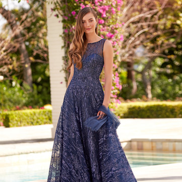 STYLE 220935  Montage  COLOR: Navy Blue, Pink Topaz  SIZES: 4 - 20, 16W - 26W  DESCRIPTION DETAILS Sleeveless embroidered lace and sparkle jersey a-line gown with an illusion neckline, drop waist, illusion back, a horsehair hem and beaded accents throughout. Separate Sleeve, Shawl Included