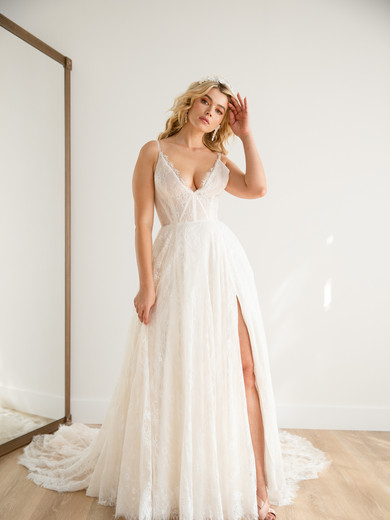 """Style: Shannon   This utterly romantic Chantilly lace ballgown features a semi sheer supportive bustier, pockets and an extra long train. The bodice can be more lined by request. Consider pairing her with our """"Roselita"""" veil for a truly dreamy finishing touch!  Available sizes: 00-30"""