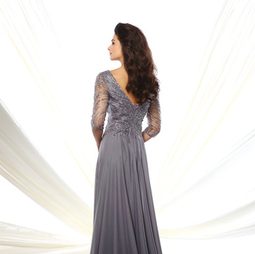 STYLE 116950  Montage  COLOR: Eggshell, Gray/Heather, Light Periwinkle, Navy Blue, Rosewood, Wine  SIZES: 4 - 20, 16W - 26W  DESCRIPTION DETAILS Diamond chiffon A-line gown with hand-beaded three-quarter length sleeves, front and back V-necklines, bodice encrusted with beading, flyaway skirt with sweep train.