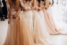 girls in wedding dresses are standing wi