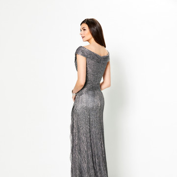 STYLE 219975  Montage  COLOR: Black, Bronze, Champagne, Gunmetal, Navy Blue  SIZES: 4 - 20, 16W - 26W  DESCRIPTION DETAILS Have your own red carpet moment in this novelty stretch sheath with cap sleeves, a wide V-neckline with a portrait collar, an asymmetrically ruched bodice, a dropped waistline, side cascading ruffles and a sweep train.