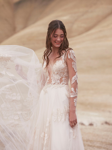 Style: Rhapsody  Our romantic gown is covered with lace bouquets worth picking, blooming from illusion bodice to satin-buttoned back to full tulle skirt.  SIZES: 00–24W