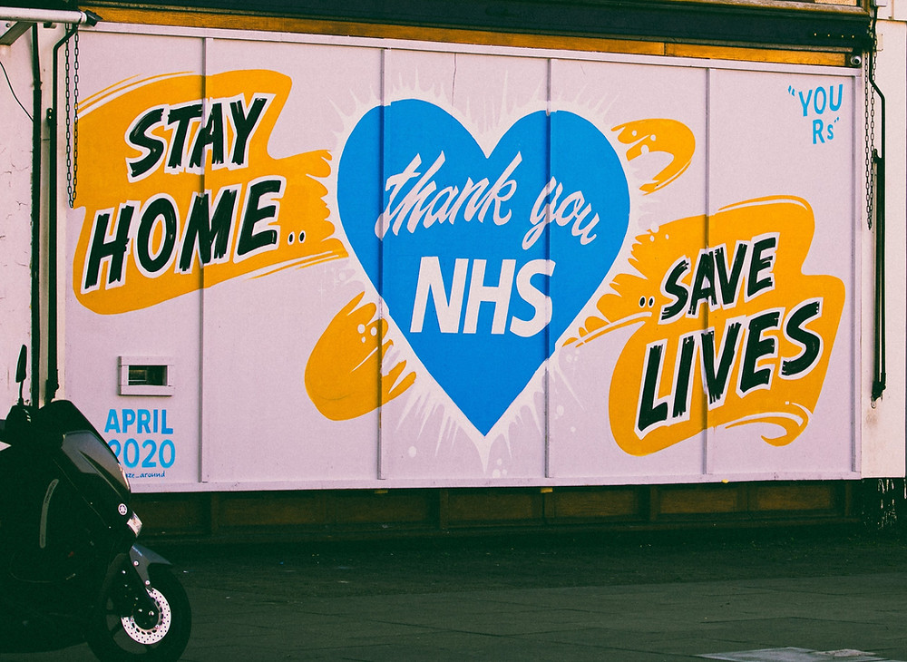 NHS logo painted on the side of a building