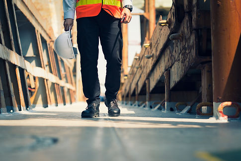 Foreman using walkie-talkie and safety b