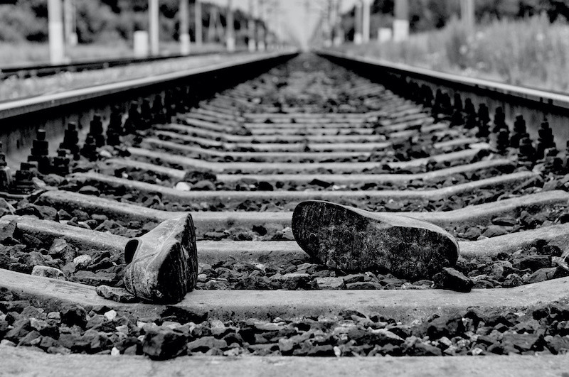 Lost shoes on the rail track indicating a rail fatality