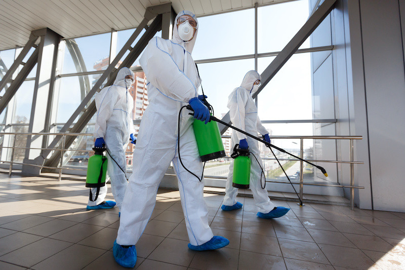 Specialist cleaners preparing to decontaminate an office building