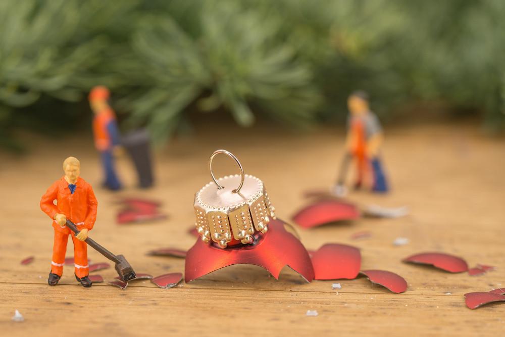 Workmen cleaning up broken decorations