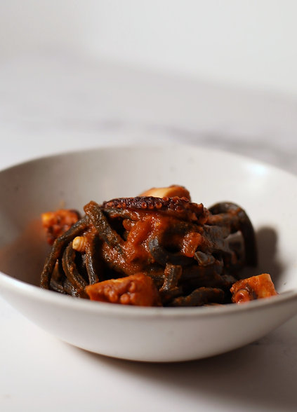 Squid ink troccoli with Octopus Ragù