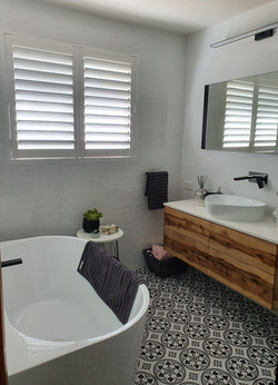 Plantation shutters in bathroom