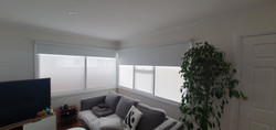 Corner window double roller blinds