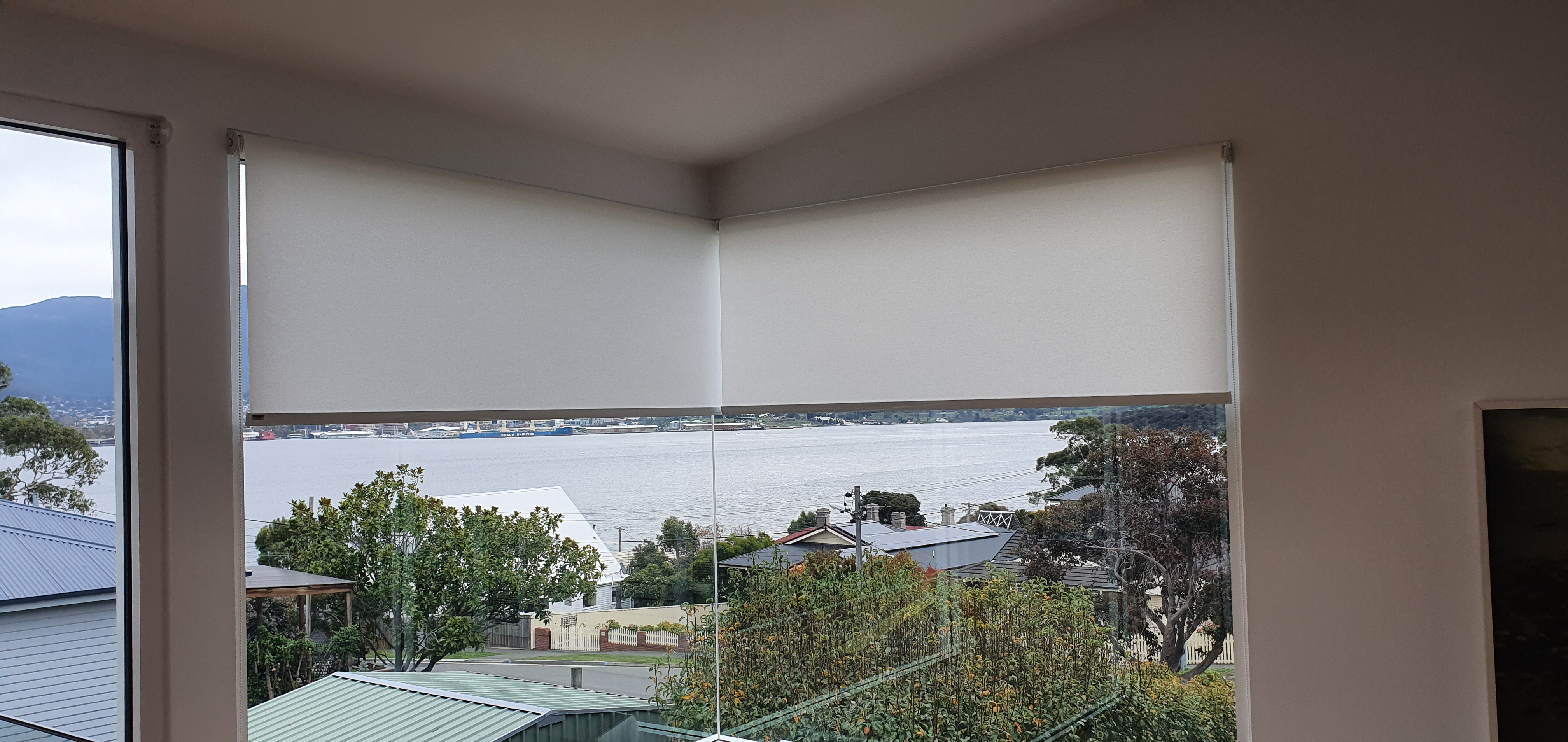 Translucent roller blinds on corner window
