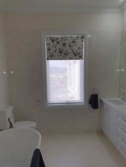 Double Roller blinds in St Lucia and Louvolite patternedfabric