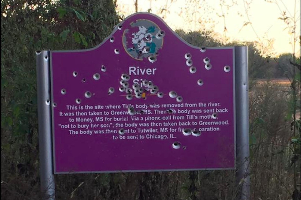 Emmett Till Memorial with bullet holes stands near where Emmett Till's badly abused body was drawn from the river.