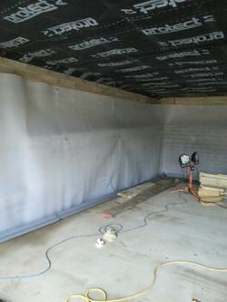 Tanking a basement retaining wall