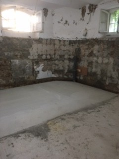 Lime sealer applied to basement