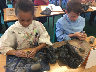 Year 5 Molding Clay Animals with local potter, Richard Parker