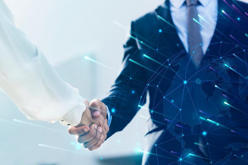 corporate-business-handshake-between-partners (1).jpg