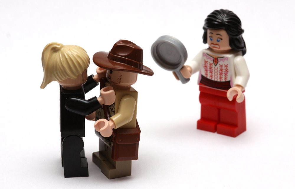 Cheating illustrated with Lego figures.
