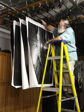 clyde butcher hangs mural prints