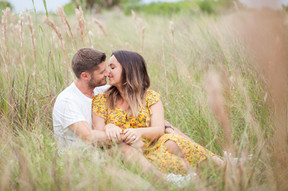 asheville natural engagement photographer of a newly engaged couple kissing in nature.