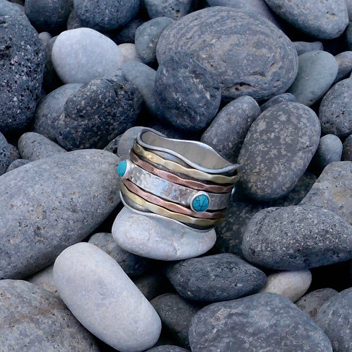 Wide band spinner ring with Turquoise accent stones