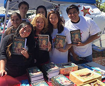 Volunteers with books