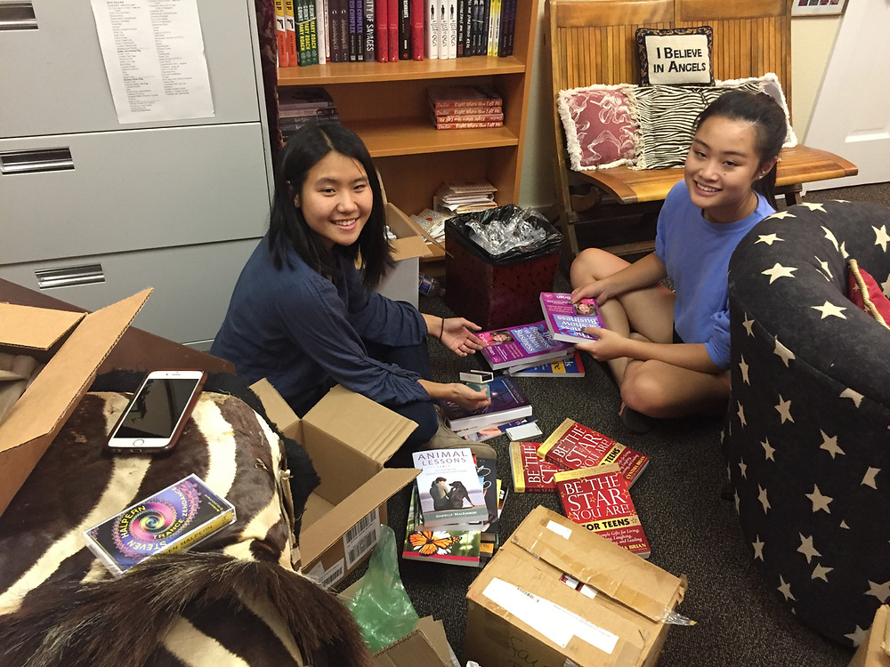 Packing books for Hurricane Relief