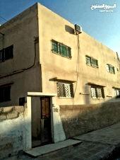 بيت مستقل طابقين للبيع في الزرقاء حي الزواهره