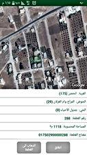 للبيع دونم أرض وبناء 500 متر وكراج في  اربد الحصن