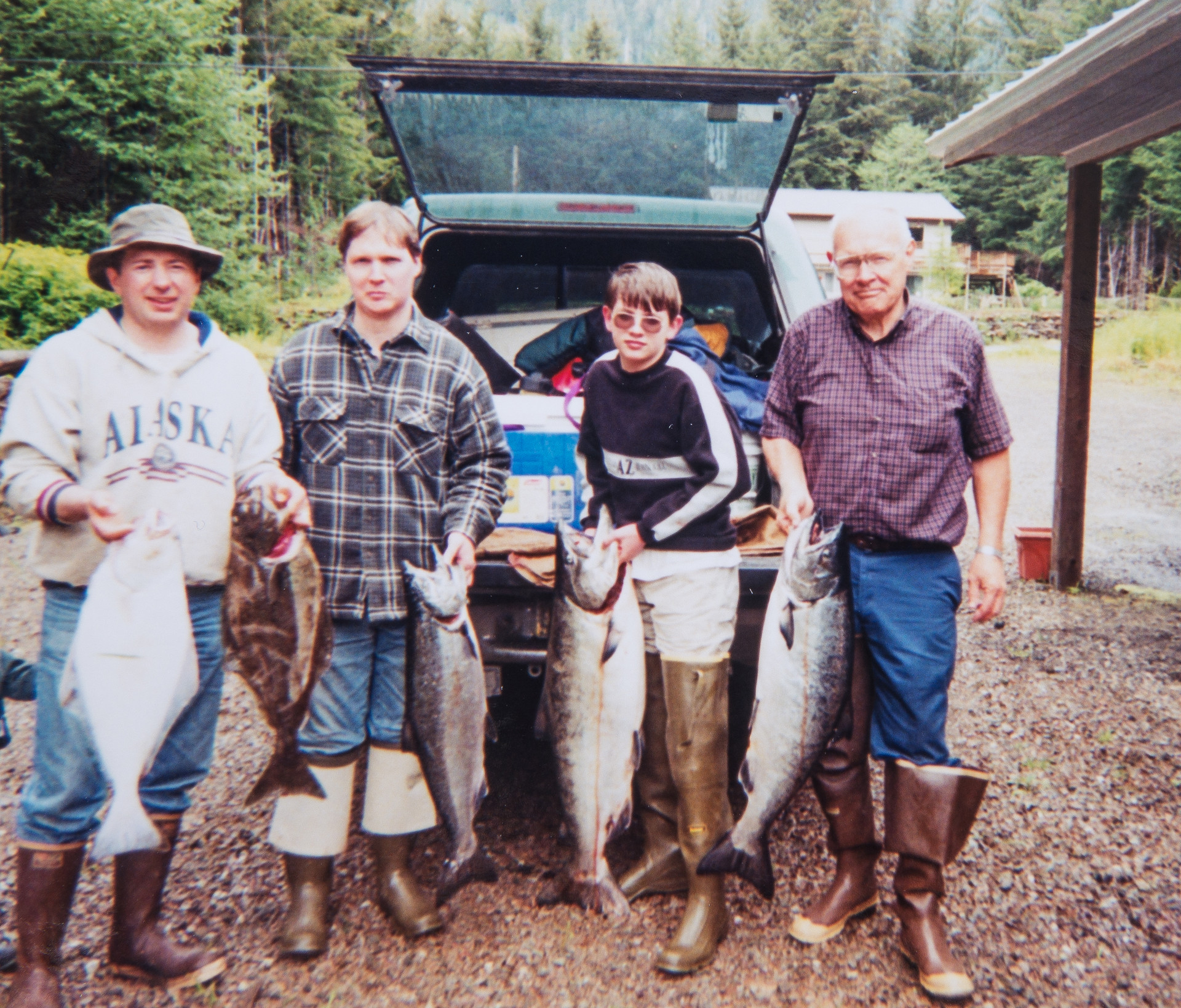 Kevin Castle with Elgin, Everett, Kenneth Cook after Fishing for King Salmon