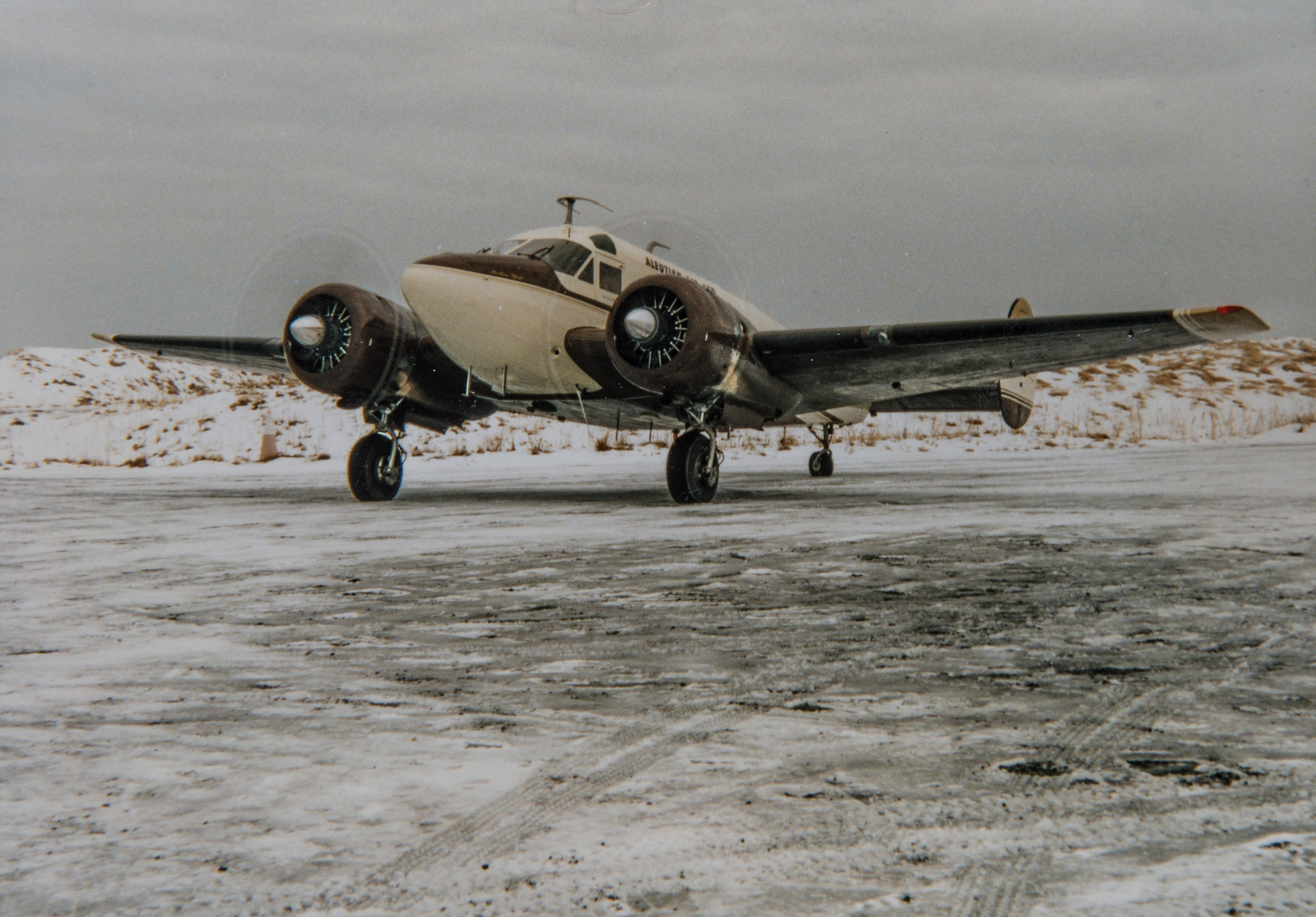 Aleutian Airlines - Tom Madsen in his 1959 Beech E18S