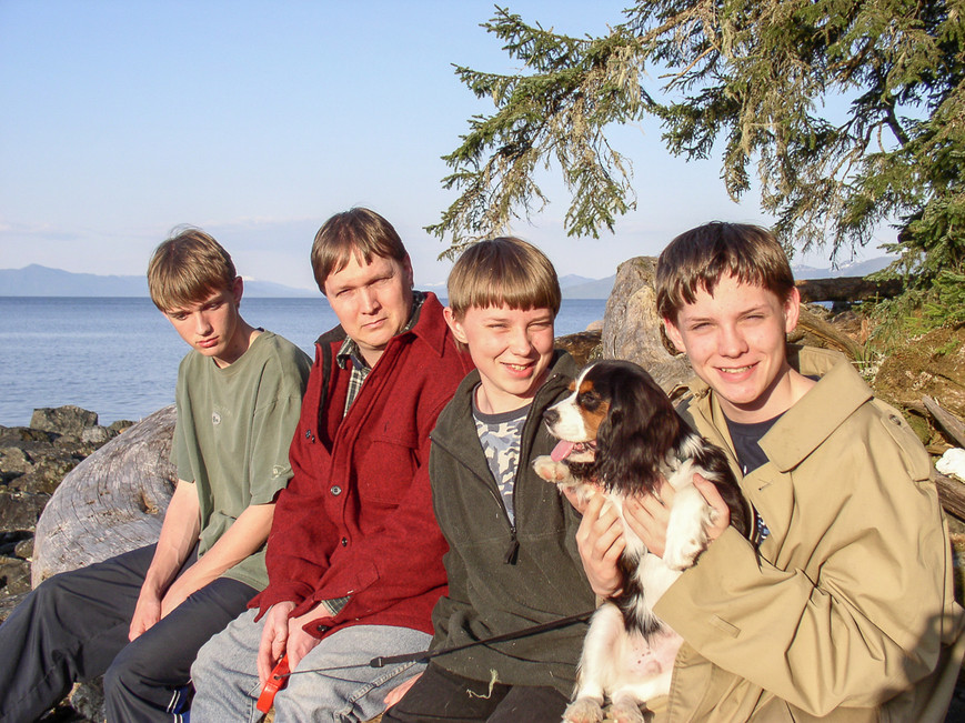 Sutton (15), Elgin (37), Ethan (12), Everett (14), and Sampson as a puppy at Sandy Beach