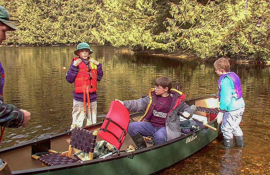 Sutton (12), Everett (11), and Ethan (9) Canoe on Sarkar Lake