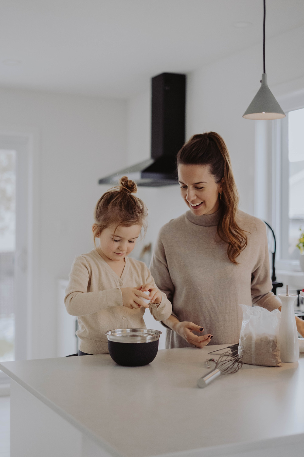 A mum cooks with her child after receiving personalised advice from The Key Clinic on the biomedical imbalances contributing to her daughter's ADHD