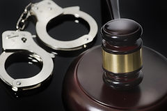 Law concept image - gavel and handcuffs.