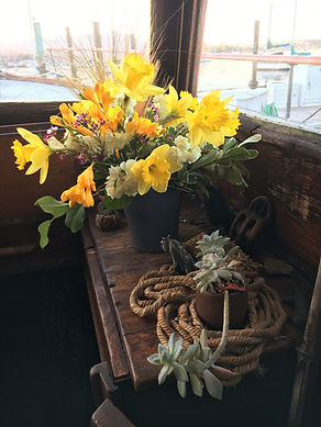 Flowers on an old wooden boat with corda