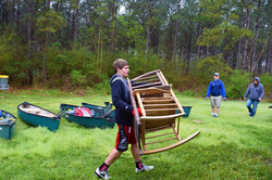 Griffin putting away rocking chairs