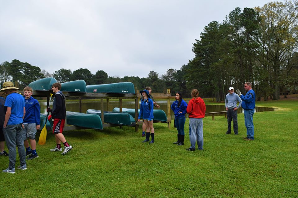 Moving canoes to lakeside