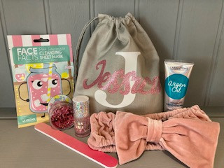 Personalised Pamper bag with all pamper accessories such as face sheet mask, hand cream, head band, body glitter nail polish and nail file is £18