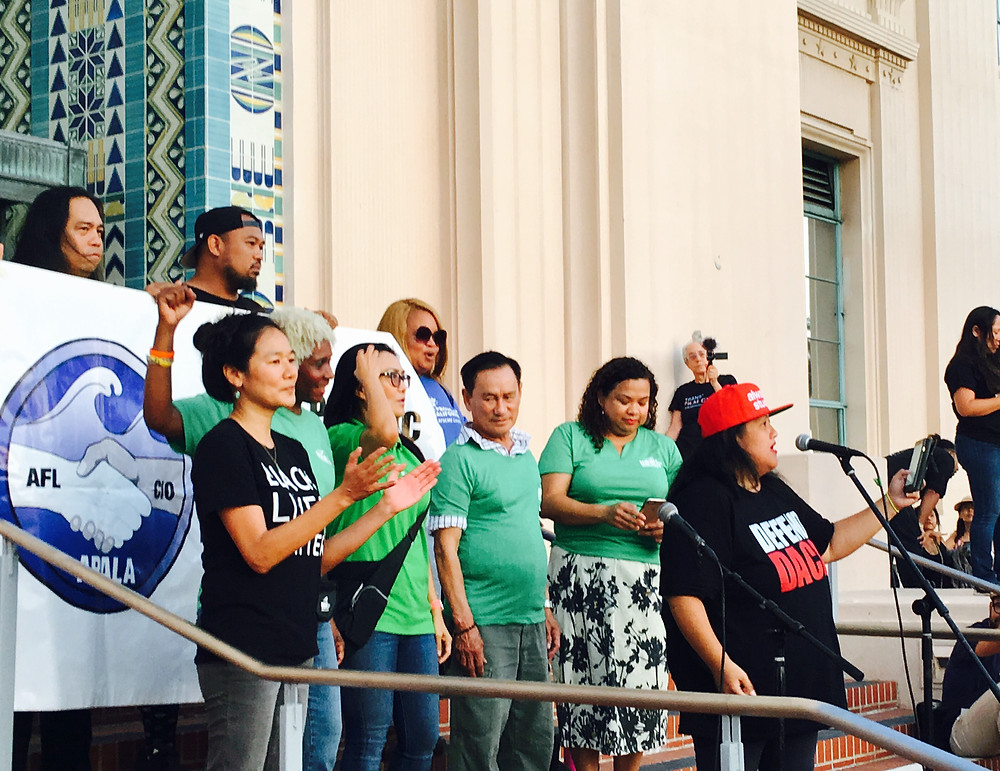 DJ Kuttin Kandi performing at San Diego's Defend Daca Rally, standing along side members of the Asian Solidarity Collective and Asian Pacific American Labor Alliance San Diego