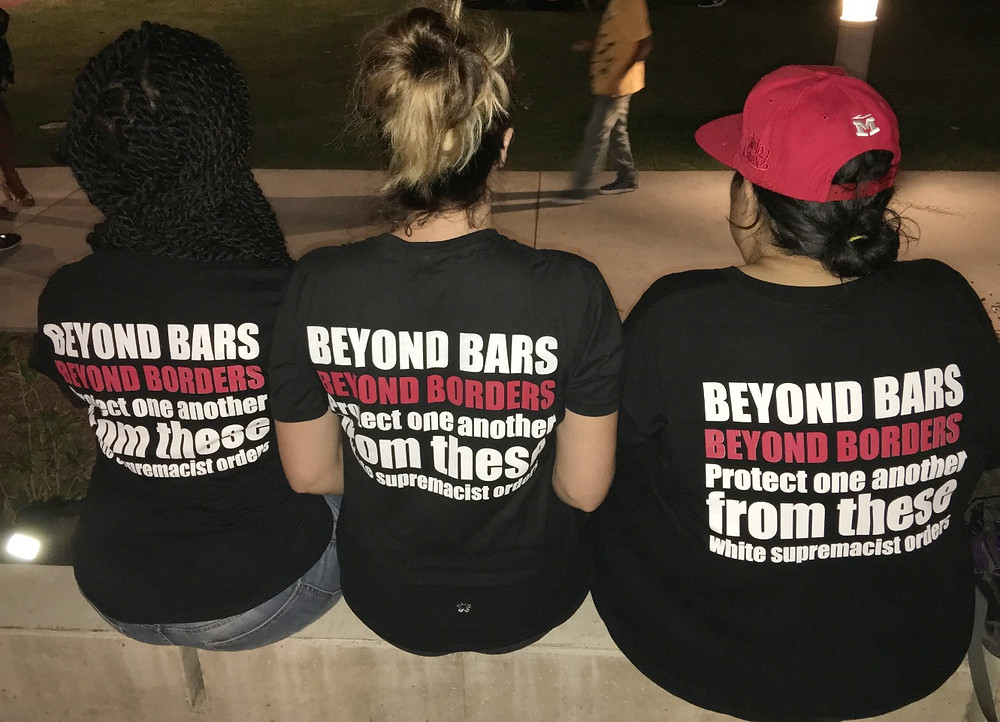 Beyond Bars Beyond Bars lyrics on t-shirts that Intersectional Feminist Collective are wearing