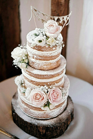 rustic-naked-wedding-cake-with-fresh-flo