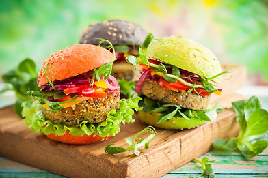 Red, green,black mini burgers with quino