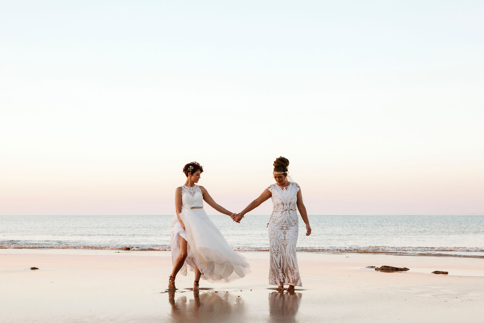Two brides on their wedding day on the beach in Eco Beach, Western Australia.