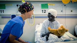 Mercy Ships nurse boy teddy bear surgery