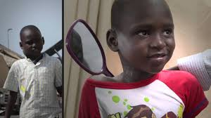 Mercy Ships boy tmor w mirror healed.jpe