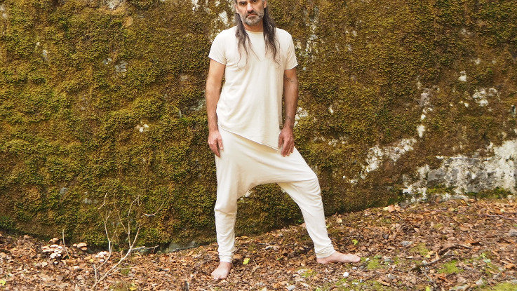 Soft and very light designer yoga pants in white natural organic cotton. Dropped crouch