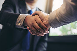 Two-business-men-shaking-hands-during-a-